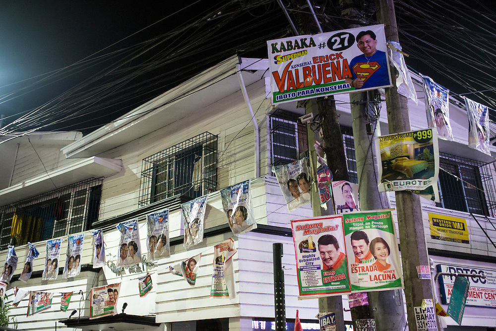MANILA, PHILIPPINES - MAY 5: Campaign posters hanging in front of a house in Remedios Circle, Malate, Manila, Philippines on May 5, 2016. The 2016 Philippine national elections will be held on 09 May.<br /> <br /> Photo by Richard A. de Guzman
