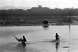 BANGLADESH COX'S BAZAAR DISTRICT COX'S BAZAAR JUL94 - Two girls fish for shrimps in the port of Cox's Bazaar during the low tide...The Bangladesh Bureau of Statistics estimates the total working child population between 5 and 17 years old to be at 7.9 million...jre/Photo by Jiri Rezac..© Jiri Rezac 1994