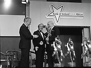 "B.O.I. GAA Allstars  (R96)..1989..03.02.1989..02.03.1989..3rd February 1989..The Awardsfor the B.O.I.Allstars were held tonight in the Burlington Hotel,Dublin. The list of the winnersis as follows..1989 - HURLING ALL STARS J. Commins (Galway), A. Fogarty (Offaly), E. Cleary (Wexford), D. Donnelly (Antrim), Conal Bonnar (Tipperary), B. Ryan (Tipperary), S. Treacy (Galway), M. Coleman (Galway), D. Carr (Tipperary), E. Ryan (Galway), Joe Cooney (Galway), O. McFetridge (Antrim), P Fox (Tipperary), Cormac Bonnar (Tipperary), N. English (Tipperary)."" 1989 - FOOTBALL ALL STARS Gabriel Irwin (Mayo), Jimmy Browne (Mayo), Gerry Hargan (Dublin), Dermot Flanagan (Mayo); Connie Murphy (Kerry), Conor Counihan (Cork), Anthony Davis (Cork); Teddy McCarthy (Cork), Willie Joe Padden (Mayo); Dave Barry (Cork) Larry Tompkins (Cork), Noel Durkin (Mayo); Paul McGrath (Cork), Eugene McKenna (Tyrone), Tony McManus (Roscommon).""..Image shows Kevin Armstrong receiving his award as all time football allstar. John Dowling, President of the GAA is presenting the award as An Taoiseach, Charles Haughey and Frank O'Rourke, Deputy Chief Executive, Bank of Ireland look on."