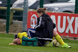 NEWPORT, WALES - Sunday, April 3, 2016: Northern Ireland's goalkeeper Jade McPhee is treated for an injury during the game against Wales on Day 3 of the Bob Docherty International Tournament 2016 at Dragon Park. (Pic by David Rawcliffe/Propaganda)