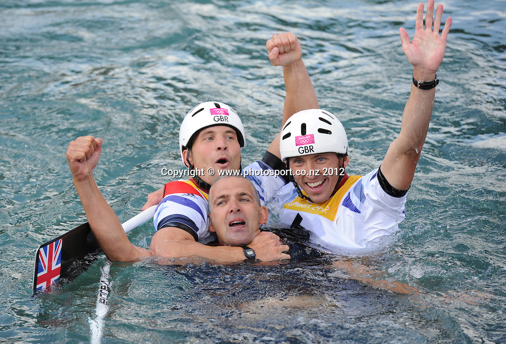 Silver medalists David Florence and Richard Hounslow with their coach in the water at the conclusion of the Men's C2 Canoe Slalom at the Lee Valley Whitewater Centre, London, United Kingdom. Thursday 2 August 2012. Photo: Andrew Cornaga/Photosport.co.nz