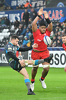 Rugby Union - 2019 / 2020 European Rugby Heineken Champions Cup - Pool Four: Ospreys vs. Saracens<br /> <br /> Will Skelton of Saracens attempts to charge down a kick from  Shaun Venter of Ospreys, at the Liberty Stadium.<br /> <br /> COLORSPORT/WINSTON BYNORTH