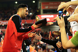 Emre Can of Liverpool receives a golden boot from a fan - Mandatory byline: Matt McNulty/JMP - 11/05/2016 - FOOTBALL - Anfield - Liverpool, England - Liverpool v Chelsea - Barclays Premier League