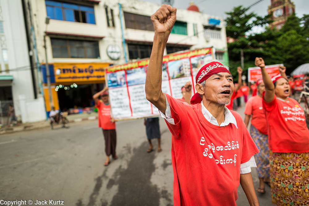 07 JUNE 2014 - YANGON, MYANMAR: A young Burmese man chants during a march through central Yangon. About 100 Burmese citizens who say they've lost their land to the Burmese army, had a protest march in central Yangon Saturday. It's a sign of how quickly Myanmar is changing that authorities allowed the march, and other protests like it, to proceed without interference.   PHOTO BY JACK KURTZ