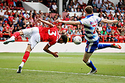 Nottingham Forest defender Tobias Figueiredo (3)  risks injury to stop Reading striker Jon Dadi Bodvarsson (23) getting in a shot during the EFL Sky Bet Championship match between Nottingham Forest and Reading at the City Ground, Nottingham, England on 11 August 2018.