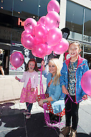 Olivia and Hannah Toner from Lackagh,with iradio's Michaela Hayes, at the opening of HMV Galwayat Edward square. Photo:Andrew Downes