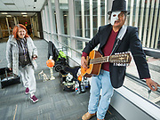 "30 OCTOBER 2019 - DES MOINES, IOWA: RANDY KONG talks about performing in the Des Moines Skywalk system. Kong said he's been busking for about nine years. He said he started when his band broke up and busking might be way to ""get a hot dog and a coke, and now it's turned into a career."" He is a regular sight in the skywalk system. In October he hands out candy and sings Halloween themed songs while wearing a ""Phantom of the Opera"" like mask. In December he does a Christmas themed show and in February he does a Valentines themed show.          PHOTO BY JACK KURTZ"