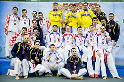 Teams of Ukraine, Croatia, Bosnia and Herzegovina and Serbia celebrate at medal ceremony after Kumite Team male at Day Two of Karate 1 World Cup - Thermana Slovenia Lasko 2014 tournament, on March 16, 2014 in Arena Tri Lilije, Lasko, Slovenia. Photo by Vid Ponikvar / Sportida