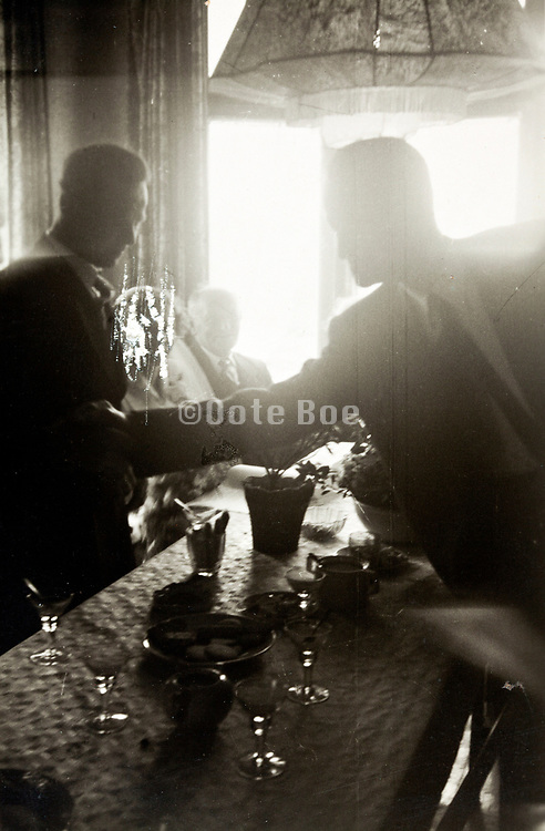 bar with liqueur glasses in the fore ground 1940s