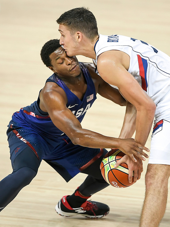 Kyle Lowry of the United States collided with Serbia's Bogdan Bogdanovich on Sunday during the men's basketball gold medal match at Carioca Arena 1 during the 2016 Summer Olympics Games in Rio de Janeiro, Brazil. The United States won, 96-66.