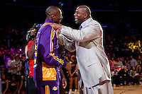 27 October 2009: Guard Kobe Bryant of the Los Angeles Lakers speaks to Magic Johnson during the Los Angeles Lakers ring ceremony before the Lakers 99-92 victory over the LosAngeles Clippers at the STAPLES Center in Los Angeles, CA.