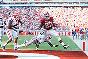 TUSCALOOSA, AL - SEPTEMBER 20: Derrick Henry #27 of the Alabama Crimson Tide powers into the end zone for a touchdown against Jarrad Davis #40 of the Florida Gators during the game at Bryant-Denny Stadium on September 20, 2014 in Tuscaloosa, Alabama. (Photo by Joe Robbins)