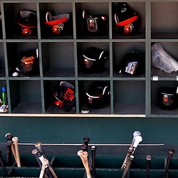 March 24, 2012; Sarasota, FL, USA; A detail of Baltimore Orioles bats and batting helmets in the dugout for a spring training game Washington Nationals at Ed Smith Stadium.  Mandatory Credit: Derick E. Hingle-US PRESSWIRE