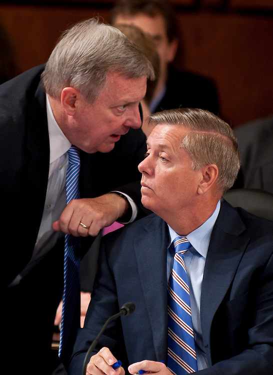 Jul 20, 2010 - Washington, District of Columbia, U.S., - Senator DICK DURBAN (D-IL) confers with Senator LINDSEY GRAHAM (R-SC) during the Senate Judiciary Committee meeting on Tuesday. The committee voted, 13-6, in favor of Solicitor General Kagan's confirmation to the Supreme Court. The vote was largely along party lines except for Senator Graham, (R-S.C.),  who broke ranks with his GOP colleagues by supporting her. The full Senate is expected to take up Kagan's nomination in early August..(Credit Image: © Pete Marovich/ZUMA Press)