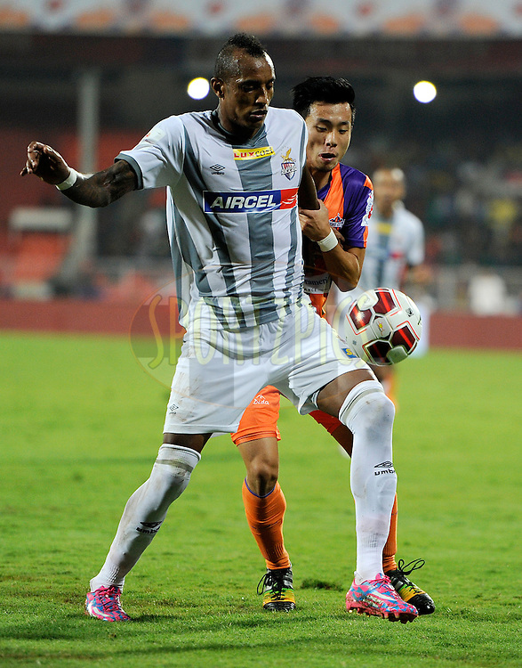Park Kwang-il of FC Pune City and Fikru Tefera Lemessa of Atletico de Kolkata during match 44 of the Hero Indian Super League between FC Pune City and Atletico de Kolkata FC held at the Shree Shiv Chhatrapati Sports Complex Stadium, Pune, India on the 29th November 2014.<br /> <br /> Photo by:  Pal Pillai/ ISL/ SPORTZPICS