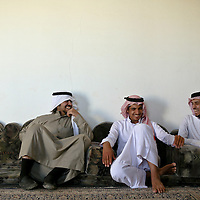 Enad al-Mutairi, left, shared a light moment with family members including his cousin Yousef al-Mutairi, right, 22, at his grandfather's house in the village of Om Salem. Like many Saudi families, theirs is large and insular, and they have spent virtually all of their free time together since childhood. March 2008.