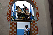 An image of Saint George sits at the Cia de Mysterios local theatre and dance company during celebrations of unofficial Rio de Janeiro's patron, Saint George, in Rio de Janeiro, Tuesday, April 23, 2013.  (Dado Galdieri)