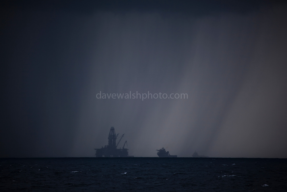 """Transocean Development Driller rig in squall at Deepwater Horizon disaster Site. Photograph made on board the Greenpeace ship Arctic Sunrise, September 2010. This mage can be licensed via Millennium Images. Contact me for more details, or email mail@milim.com For prints, contact me, or click """"add to cart"""" to some standard print options."""