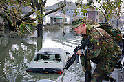 National Guardsmen patrol the Lakeview neighborhood of New Orleans in airboats after Hurricane Katrina and the subsequent levee failure caused massive flooding.. <br />
