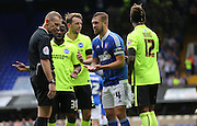 Ipswich Town defender Luke Chambers skipper remonstrates with referee Keith Hill during the Sky Bet Championship match between Ipswich Town and Brighton and Hove Albion at Portman Road, Ipswich, England on 29 August 2015.