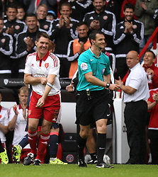 Sheffield United's Chris Morgan and referee Andrew Madley smile at Morgan's non sending off - Mandatory by-line: Robbie Stephenson/JMP - 26/07/2015 - SPORT - FOOTBALL - Sheffield,England - Bramall Lane - Sheffield United v Newcastle United - Pre-Season Friendly