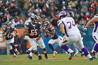 25 November 2012: Cornerback (26) Tim Jennings of the Chicago Bears intercepts a pass and returns in against the Minnesota Vikings before it is called back because of a penalty during the second half of the Bears 28-10 victory over the Vikings in an NFL football game at Soldier Field in Chicago, IL.