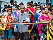 30 AUGUST 2016 - BANGKOK, THAILAND: People line up to get into the Poh Teck Tung shrine for the food distribution at the end of Hungry Ghost Month in Bangkok. Chinese temples and shrines in the Thai capital host food distribution events during Hungry Ghost Month, during the 7th lunar month, which is usually August in the Gregorian calendar.         PHOTO BY JACK KURTZ
