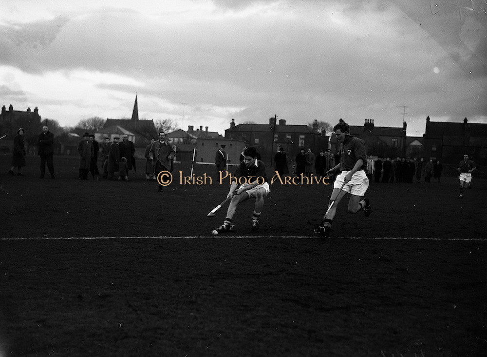 16/01/1960<br /> 01/16/1960<br /> 16 January 1960<br /> Interprovincial Mens Hockey: Munster v Leinster. Munster right wing forward, Hurley (on left) centres the ball despite the attention of Leinster defender, Judge (right), during the match at Londonbridge Road, Dublin.
