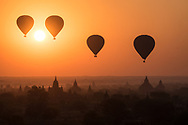 The Hot air baloons rising over Bagan Temples area at sunrise are really an iconic and unforgettable view. The morning mist covering the ground, make the landscape look magical and surreal.
