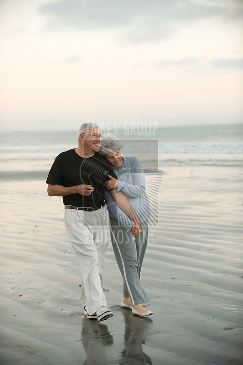 Senior couple walking the beach