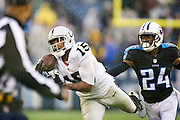 NASHVILLE, TN - NOVEMBER 29:  Michael Crabtree #15 of the Oakland Raiders just misses a pass while being defended by Coty Sensabaugh #24 of the Tennessee Titans at Nissan Stadium on November 29, 2015 in Nashville, Tennessee.  (Photo by Wesley Hitt/Getty Images) *** Local Caption *** Michael Crabtree; Coty Sensabaugh