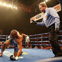 "Nat Heaven (silver shorts) wins against Donovan Dennis by TKO during  the ESPN ""Boxcino"" boxing tournament at Turning Stone Resort Casino on Friday, April 18, 2014 in Verona, New York.  (AP Photo/Alex Menendez)"