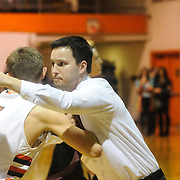 Ashley High School Head Basketball Coach Webster Guthrie greets New Hanover player Blake Smith before the school's varsity game against New Hanover High School Friday December 19, 2014 at New Hanover High School in Wilmington, N.C. (Jason A. Frizzelle)