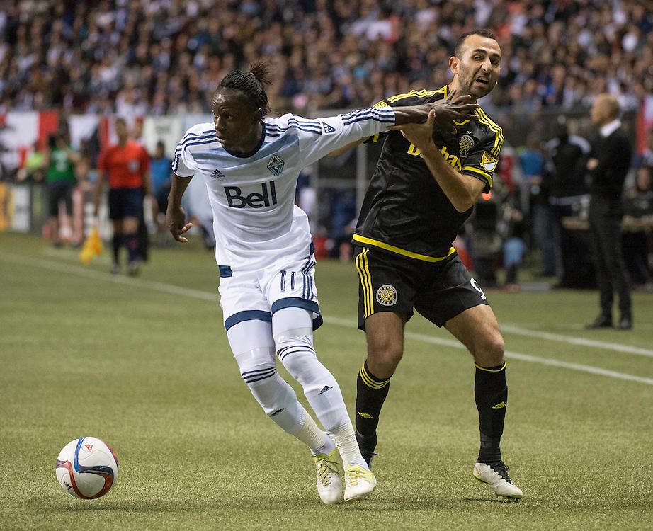 MLS Soccer- Vancouver Whitecaps FC vs. the Columbus Crew SC at BC Place Stadium in Vancouver:  Whitecaps Darren Mattocks (left) and Columbus Crew Justin Meram.