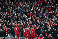 Football - 2019 / 2020 Premier League - Liverpool vs. Manchester City<br /> <br /> Liverpool fans celebrates their sides second goal scored by Mohamed Salah, at Anfield.<br /> <br /> COLORSPORT/PAUL GREENWOOD