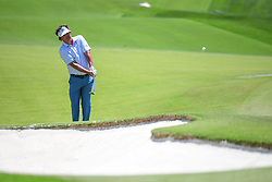 May 2, 2019 - Charlotte, NC, U.S. - CHARLOTTE, NC - MAY 02: Jason Dufner hits an approach shot to the 14th green during the first round of the Wells Fargo Championship at Quail Hollow on May 2, 2019 in Charlotte, NC. (Photo by William Howard/Icon Sportswire) (Credit Image: © William Howard/Icon SMI via ZUMA Press)
