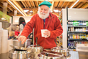 Richard Ellmyer tries out the clam chowder on opening day Green Zebra Grocery