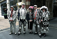 A group of pearly kings and queens pictured at Buckinham Gate on the way to celebrate Queen Elizabeth II's Golden Jubilee. Celebrations took place across the United Kingdom with the centrepiece a parade and fireworks at Buckingham Palace, the Queen's London residency. Queen Elizabeth ascended to the British throne in 1952 upon the death of her father, King George VI.