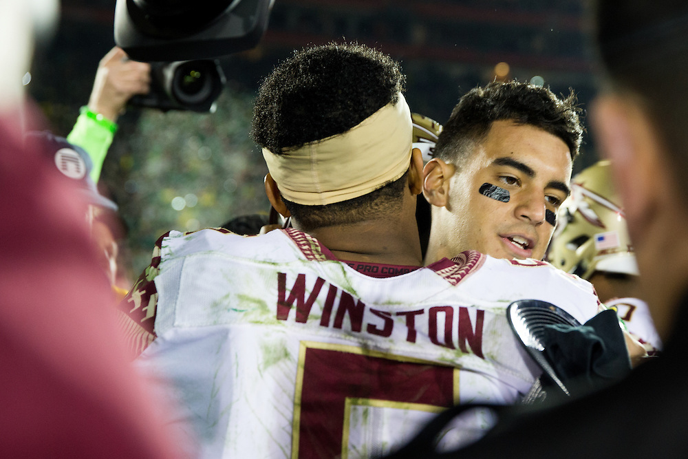 Marcus Mariota, Quarterback, University of Oregon, and Jameis Winston, quarterback, Florida State University. Photographed at the 2015 Rose Bowl Game in Pasadena, California, on January 1, 2015. (Photograph ©2015 Darren Carroll)