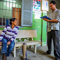 Cambodia has been dealing with the insurmountable task leftover from decades of war and its legacy, unexploded ordnance or UXOs. Estimates range from 3 to 9 million unexploded bombs that are still just beneath the surface throughout the region. These bombs are left over from air strikes, artillery fire, mortar shells, rockets, grenades, anti-personnel and anti-vehicle land mines are indiscriminate weapons and do not expire, often killing or injuring between 100 to 200 people in Cambodia a year. With little resource, the countries' people and Non Governmental Organizations (NGOs) are still facing over a hundred years being exposed to this deadly issue while walking and cultivating their land in fear.<br /> <br /> Amputee Rach Lorm gives information about the fit of her new prosthetic leg at The Handicap International Physical Rehabilitation and Information Center in Siem Reap, Cambodia, Jan. 2013.
