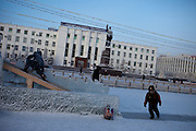 Children playing at Lenin square in Yakutsk. Yakutsk is a city in the Russian Far East, located about 4 degrees (450 km) below the Arctic Circle.