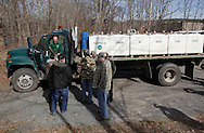 Members of the Orange County Federation of Sportsmen gather around a Department of Environmental Conservation truck carries trout to be stocked in the Neversink River in Cuddebackville on Wednesday, March 30, 2011.