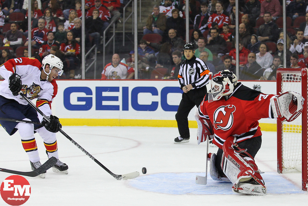 Mar 23, 2013; Newark, NJ, USA; New Jersey Devils goalie Martin Brodeur (30) makes a save on Florida Panthers center Quinton Howden (42) during the second period at the Prudential Center.