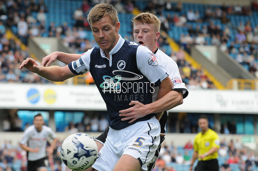 Tony Craig protects the ball during the Sky Bet League 1 match between Millwall and Rochdale at The Den, London, England on 26 September 2015. Photo by Michael Hulf.