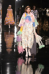 "© Licensed to London News Pictures. 05/06/2013. London, England. A model walks down the catwalk wearing a design by graduate fashion student Chen Yu Wang of Ravensbourne College  during the ""Best of Graduate Fashion Week"" gala show at Earl's Court 2. Graduate Fashion Week 2013 showcasing student collections takes place at Earl's Court II from 2 to 5 June 2013. Photo credit: Bettina Strenske/LNP"