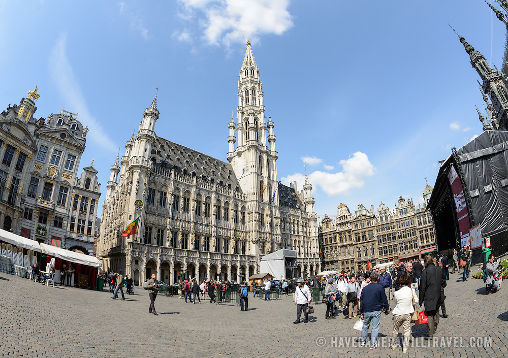 A fisheye shot of the the Grand Place, Brussels. Originally the city's central market place, the Grand-Place is now a UNESCO World Heritage site. Ornate buildings line the square, including guildhalls, the Brussels Town Hall, and the Breadhouse, and seven cobbelstone streets feed into it.