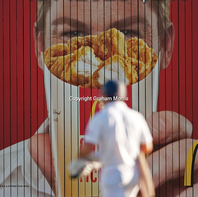 Shane Warne hides behind a bucket of fried chicken (on an advert) during the third Ashes test match between Australia and England at the WACA (West Australian Cricket Association) ground in Perth, Australia. Photo: Graham Morris (Tel: +44(0)20 8969 4192 Email: sales@cricketpix.com) 16/12/10