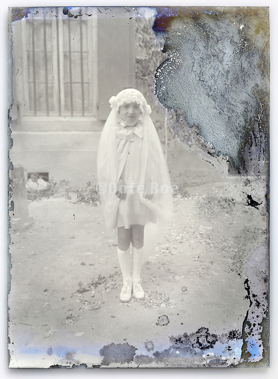 eroding glass plate with young girl in holy communion clothing