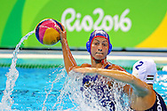 Aug 3, 2016; Rio de Janeiro, USA;  Russia driver Ekaterina Prokofyeva (3)  shoots the ball against Hungary driver Dora Czigany (2) during the women's water polo bronze medal match in the Rio 2016 Summer Olympic Games at Olympic Aquatics Stadium. Mandatory Credit: Peter Casey-USA TODAY Sports