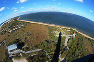 Babylon, NY,  October 25, 2016: ---  Looking down from the gallery of the Fire Island Lighthouse at the boat house and reflection of the lighthouse.     © Audrey C. Tiernan